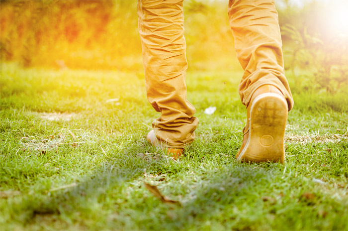 A person walking in a field